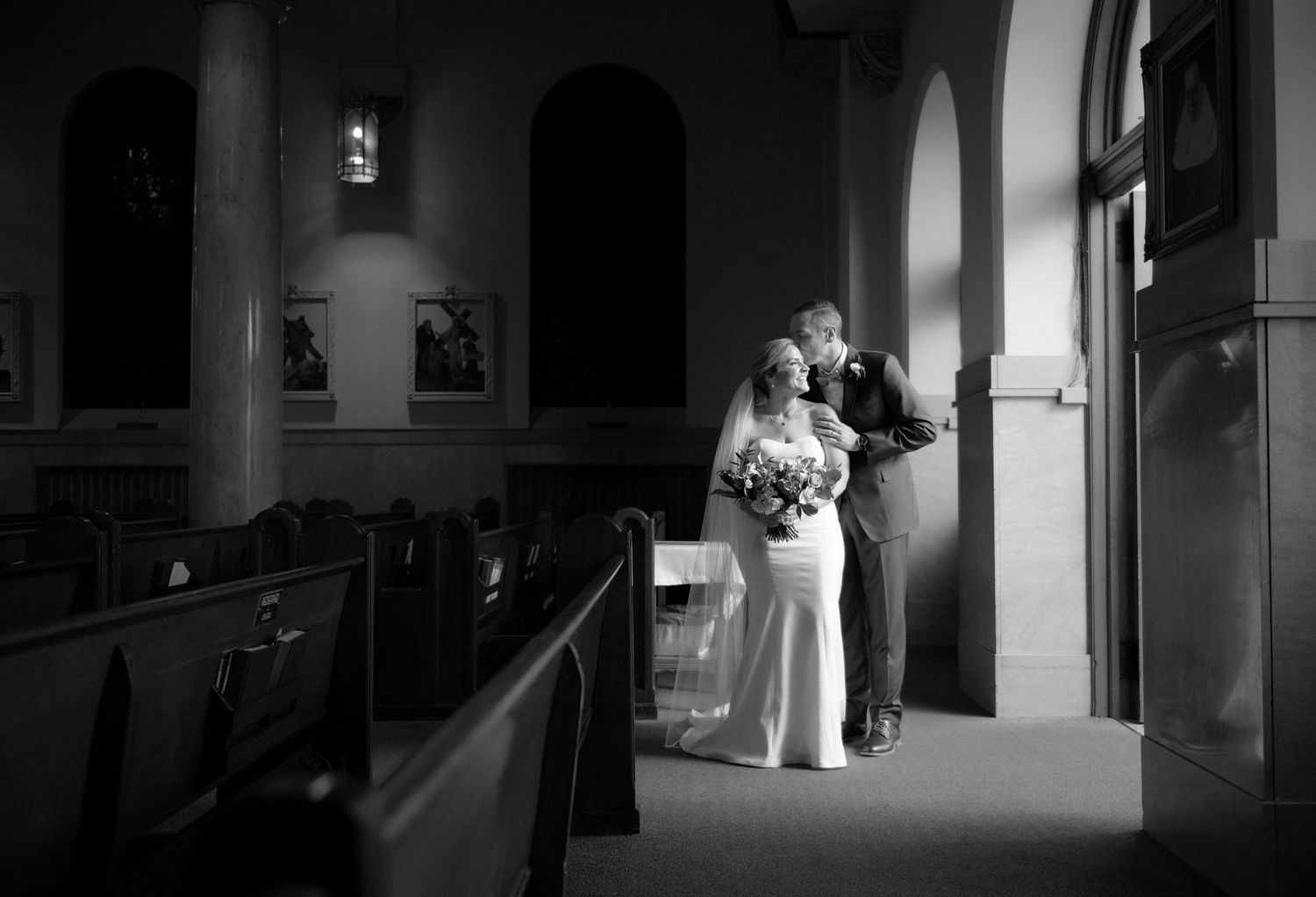 bride and groom candid portrait at church
