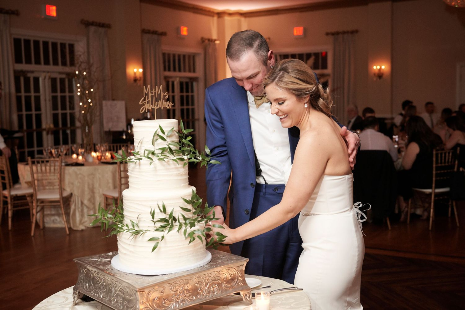 bride and groom cutting the cake at Belle Voir Manor