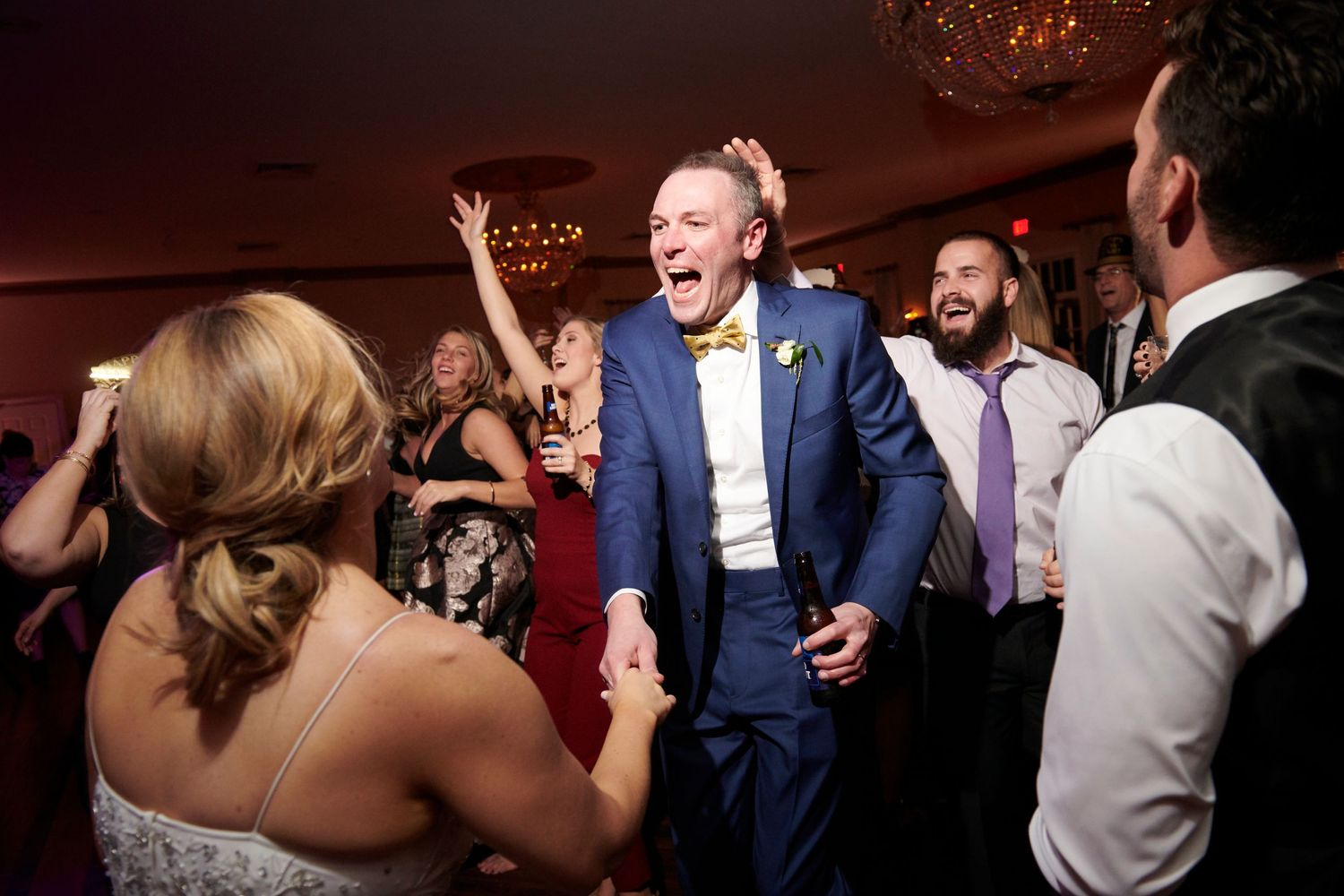 groom dancing during reception at Belle Voir Manor