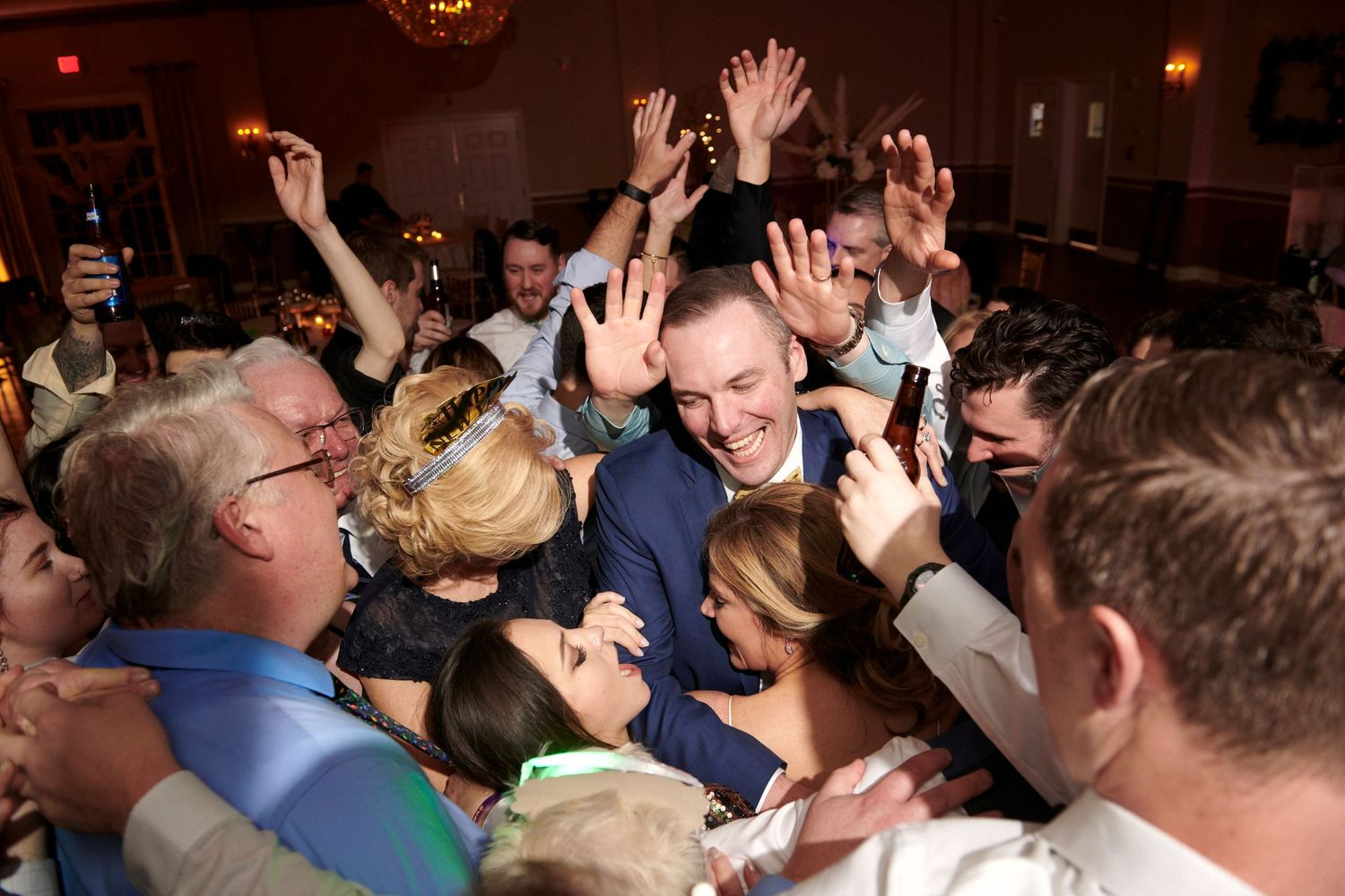 bride and groom group hug during reception at Belle Voir Manor