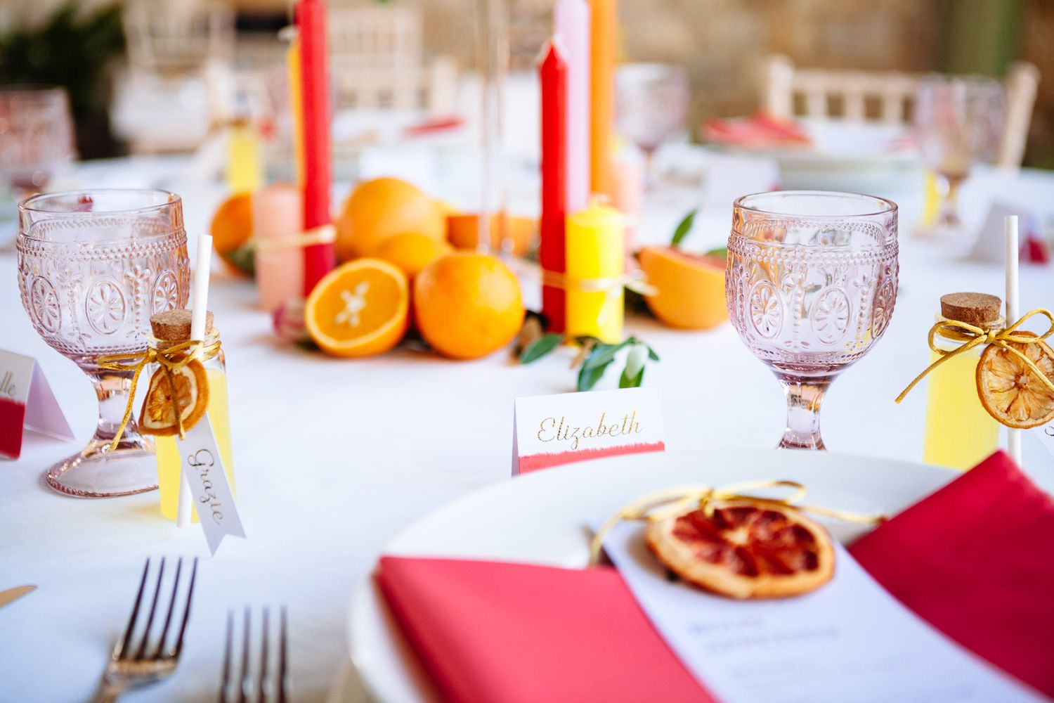 bright and bold table setting for intimate wedding in marina di pietrasanta, tuscany, italy