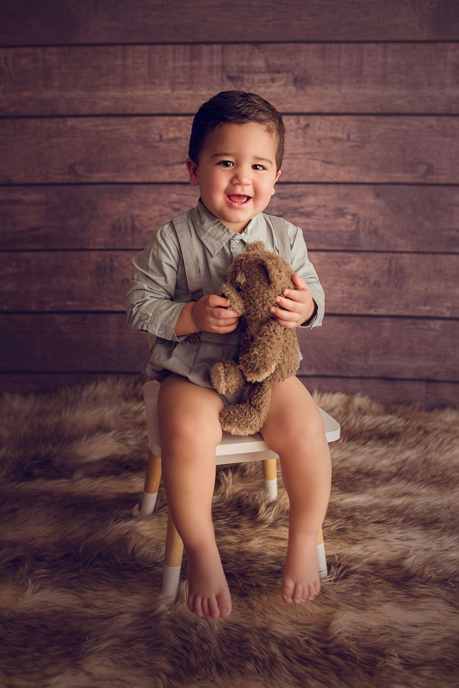 toddler baby boy holding teddy bear one year old