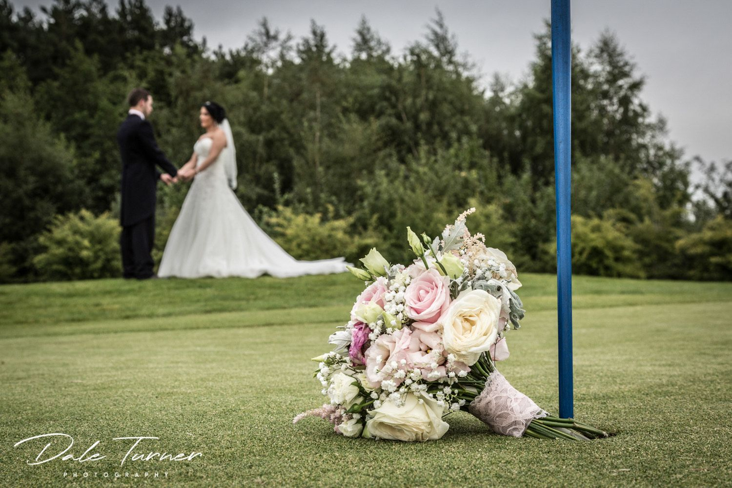 Bride and groom on golf course