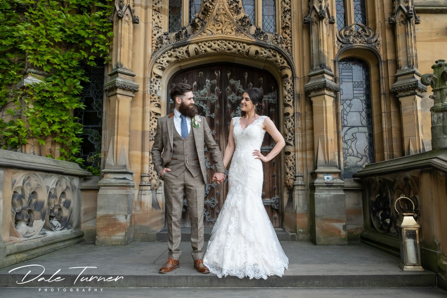 Bride and groom looking at each other on the stairs of Carlton Towers