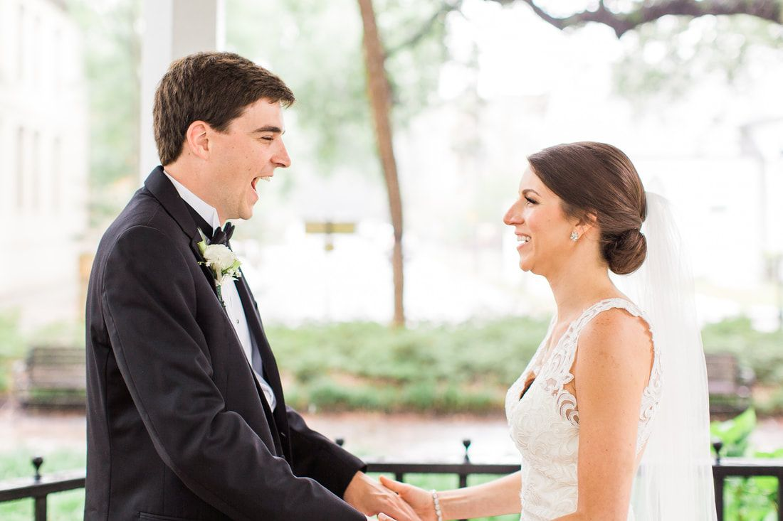 bride and groom share their first look in whitefield square in downtown savannah