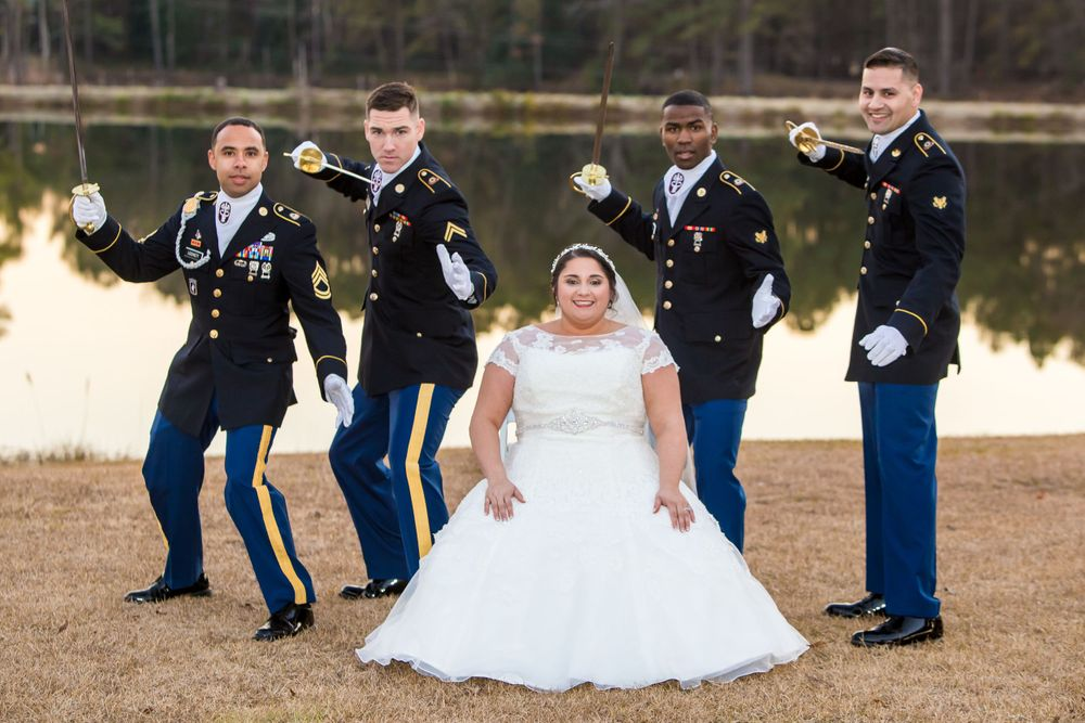 Bride Katie poses with her Army groomsmen following her wedding at the Fort Jackson Officers Club in Columbia, SC