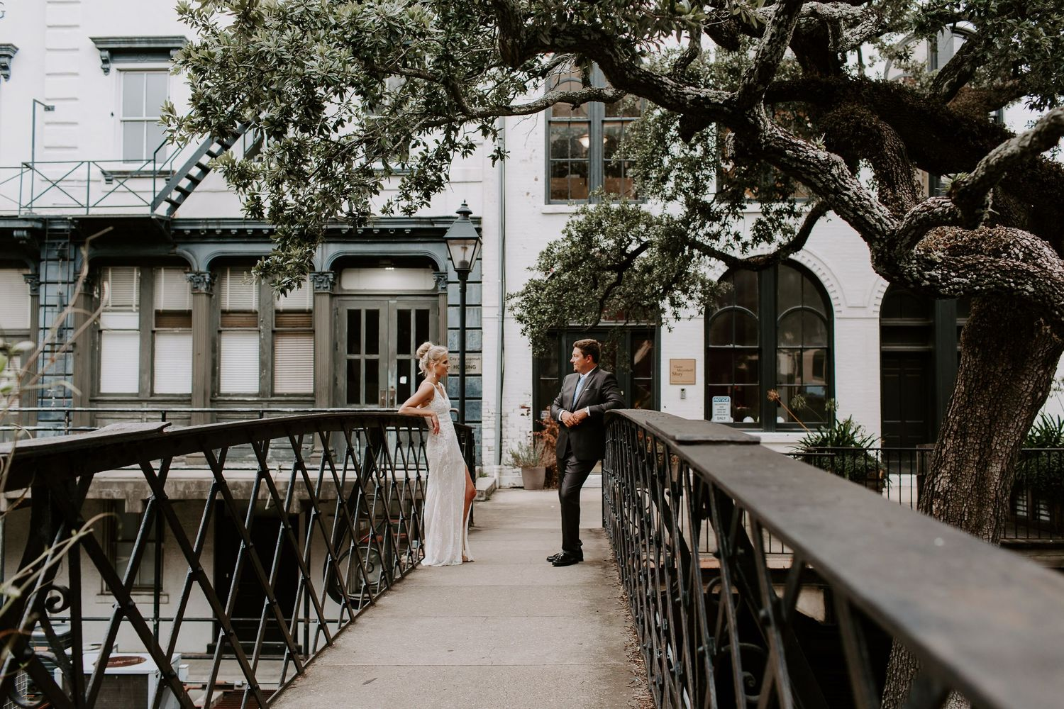 couple standing on a suspension bridge in downtown Savannah during their urban Georgia elopement