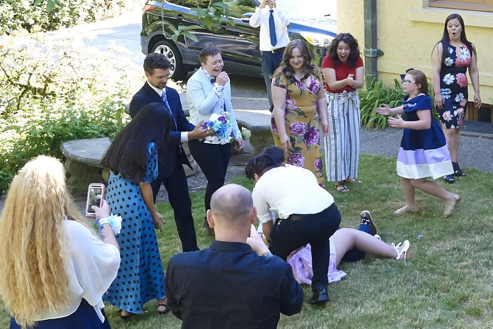 Groomsmen tackles bridesmaid during bouquet toss at Lord Mansion, Olympia, WA