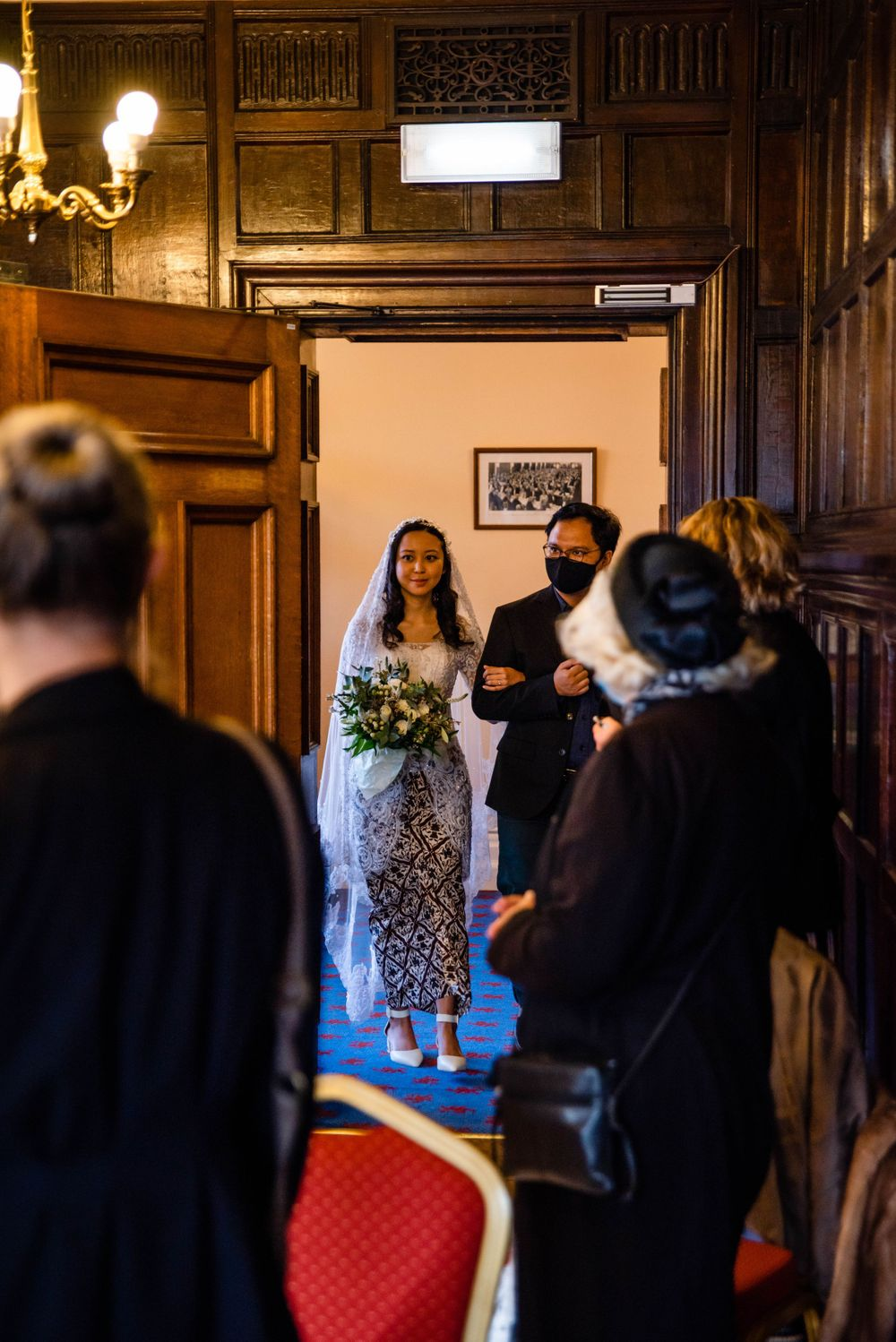 Cotswolds based Zara Davis Wedding Photography at Hereford Town Hall Herefordshire bride walking in