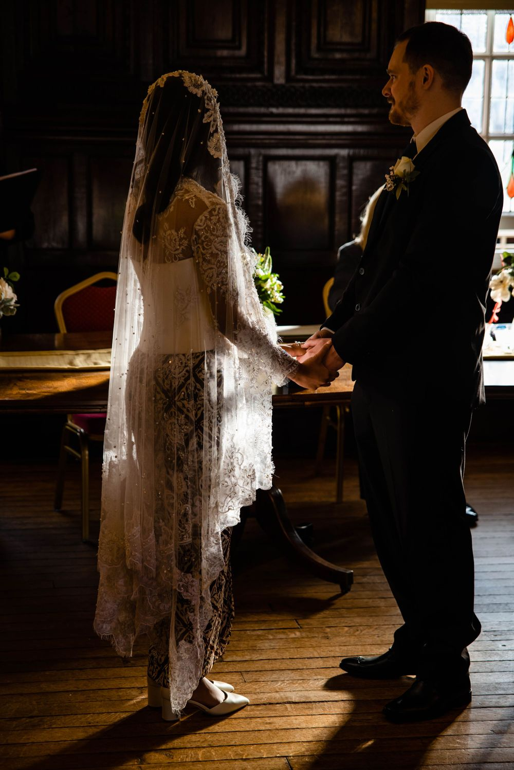 Cotswolds based Zara Davis Wedding Photography at Hereford Town Hall Herefordshire sunlight through veil
