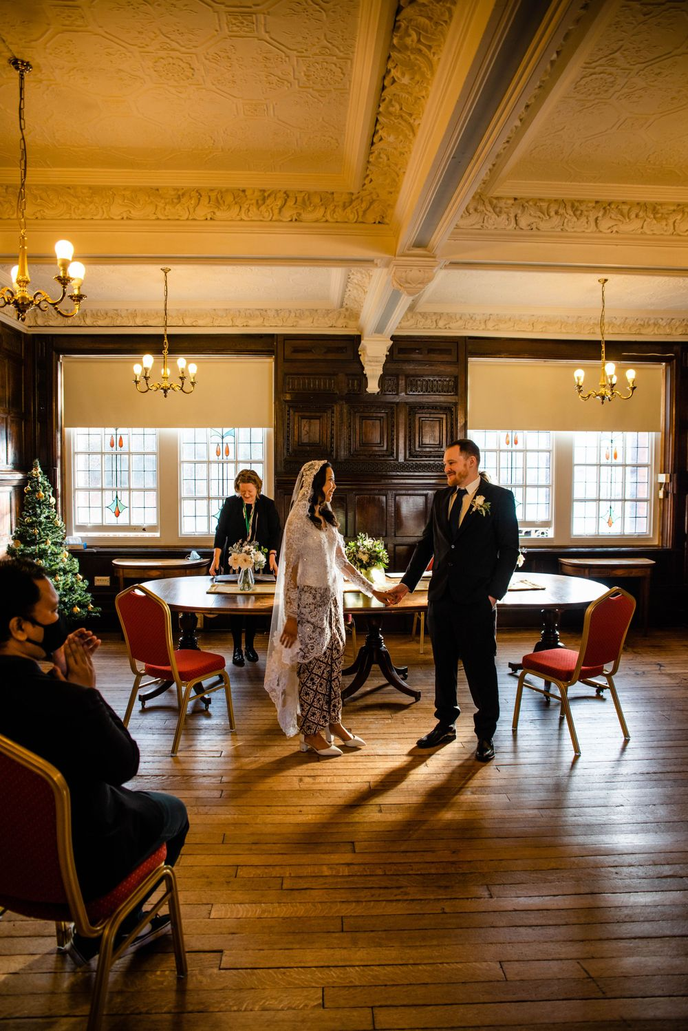 Cotswolds based Zara Davis Wedding Photography at Hereford Town Hall Herefordshire declared husband and wife
