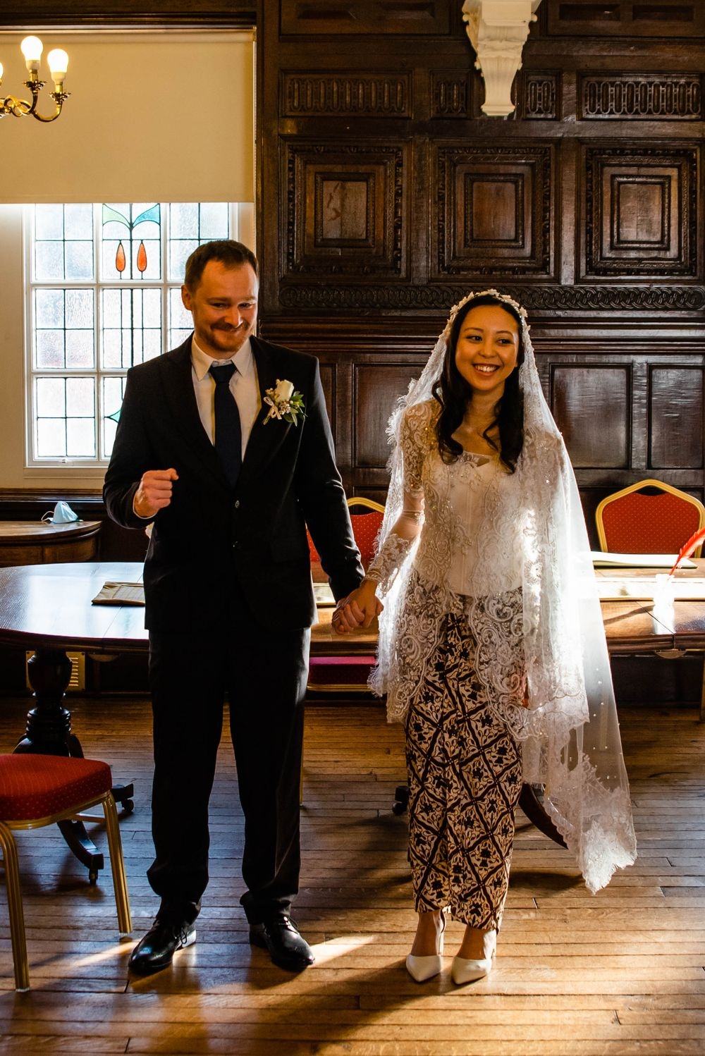 Cotswolds based Zara Davis Wedding Photography at Hereford Town Hall Herefordshire groom air punch happy