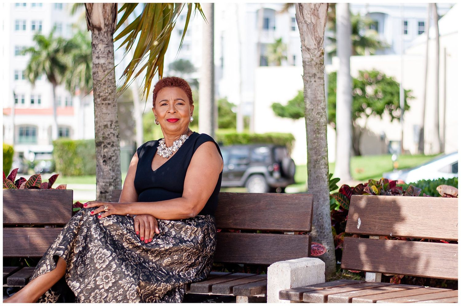 woman sitting on bench at Downtown West Palm Beach session