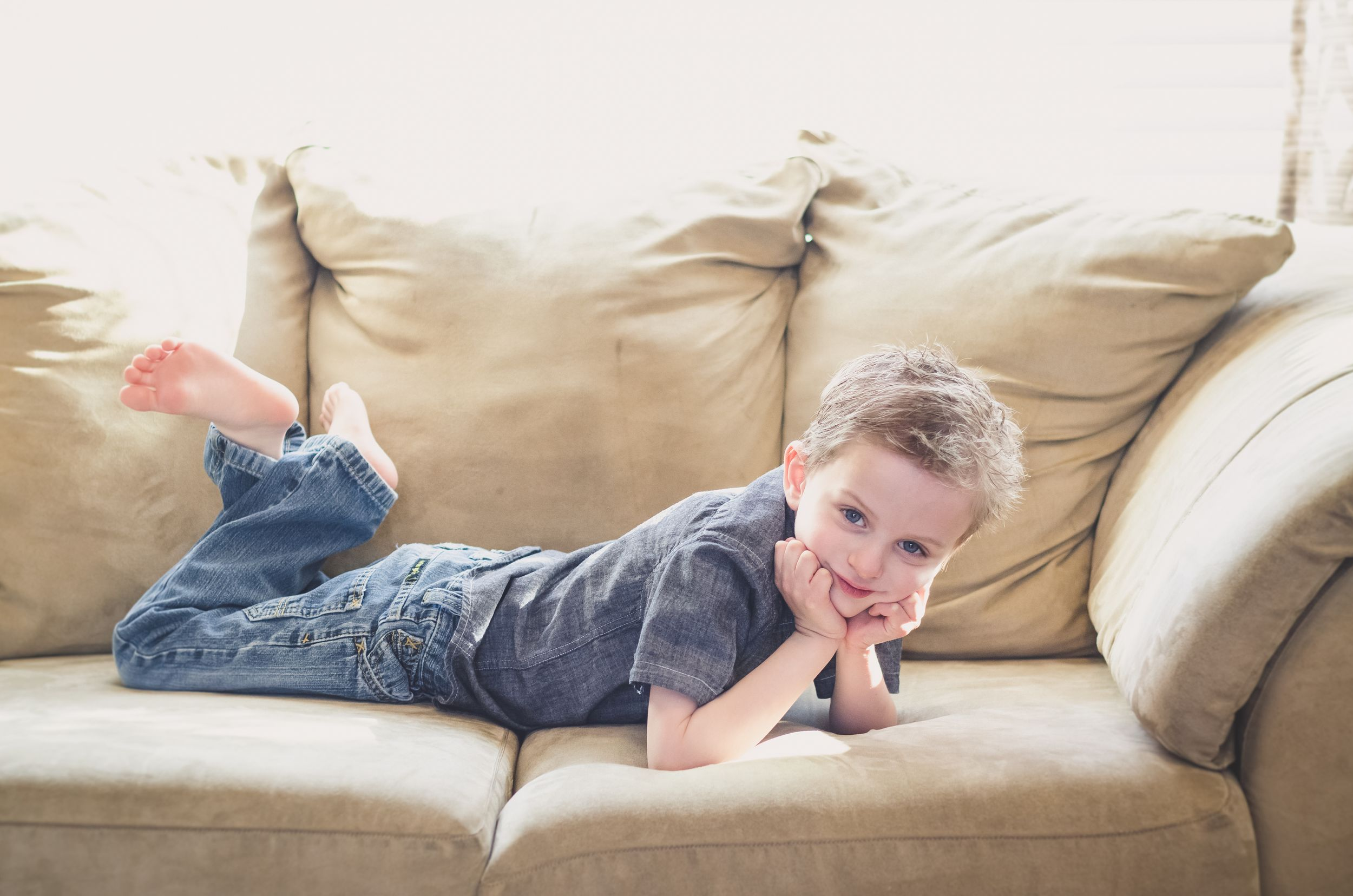 boy relaxed on a sofa