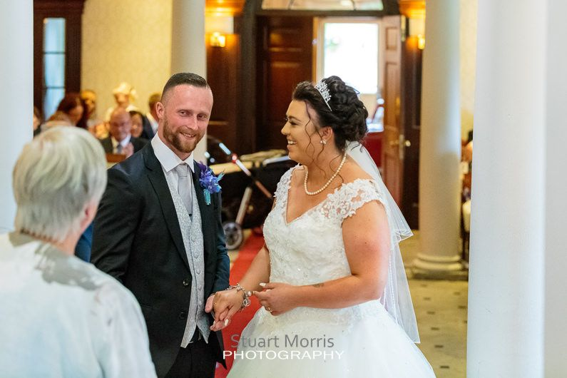 bride and groom say their vows during the ceremony at the mercure hotel haydock