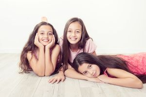 3 sisters relaxing on floor