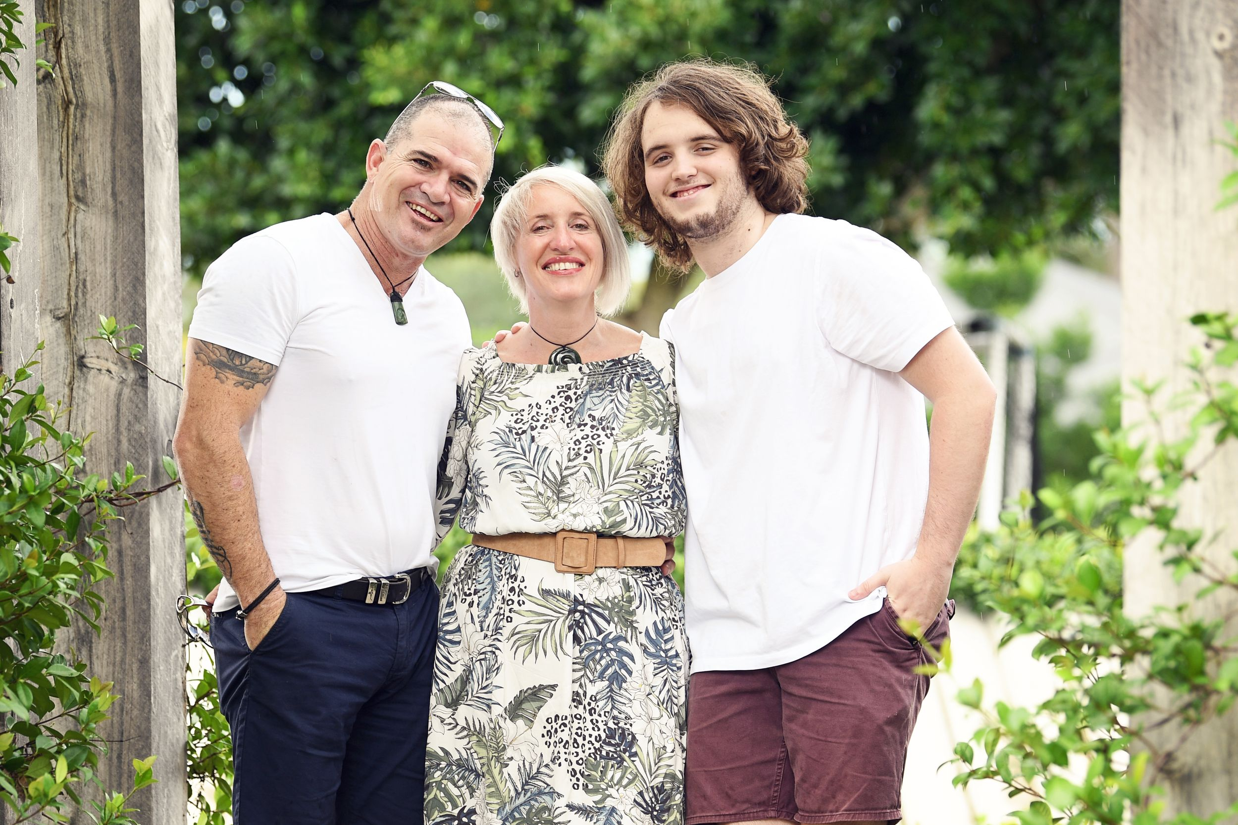 Proud Mum and Dad with son in a garden