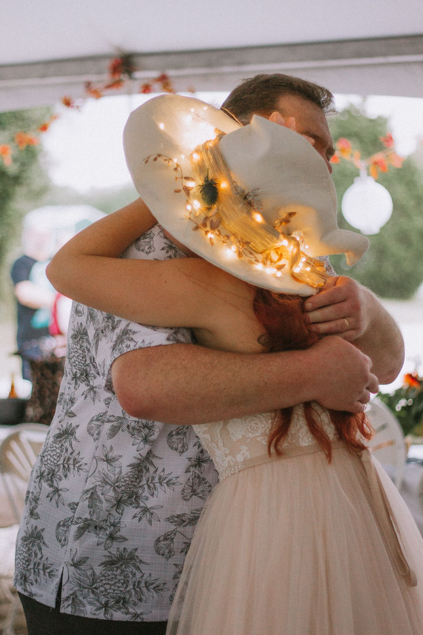 bride hugging her father during intimate wedding reception