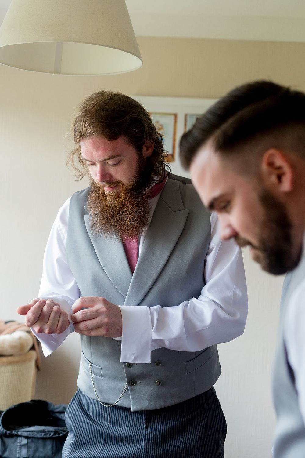 putting on wedding suit