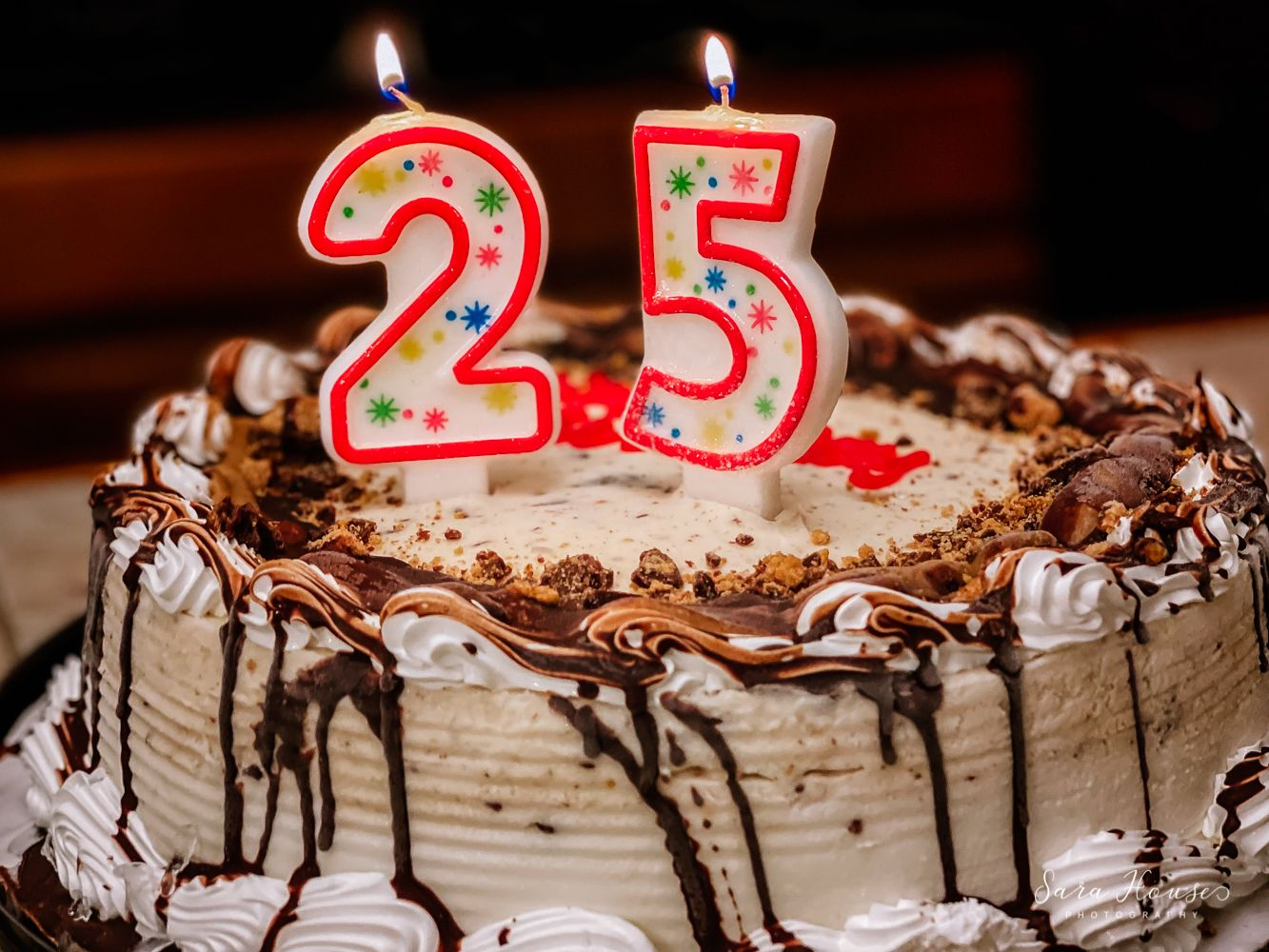 Birthday ice cream cake with the number 25 candles at a birthday party in Brownsburg, Indiana
