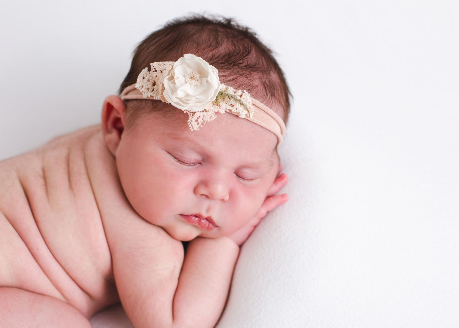 nebworn posed on baby blanket with headband - penticton bc newborn photography