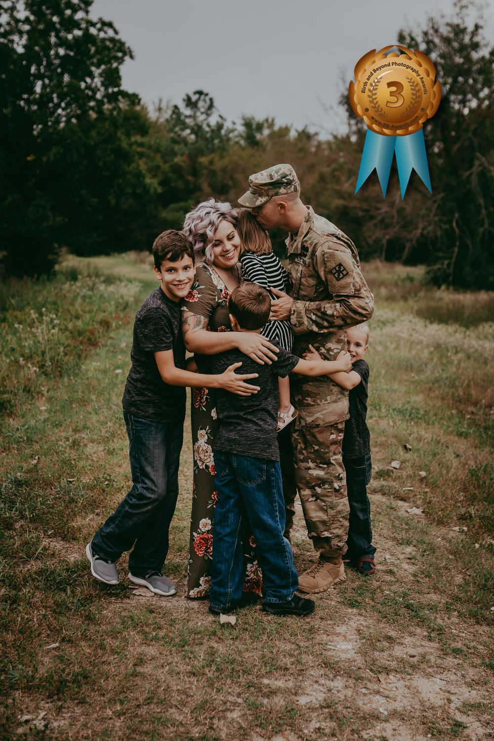 A family huddled together embracing each other happily. The father is wearing a military uniform. Award-winning image.