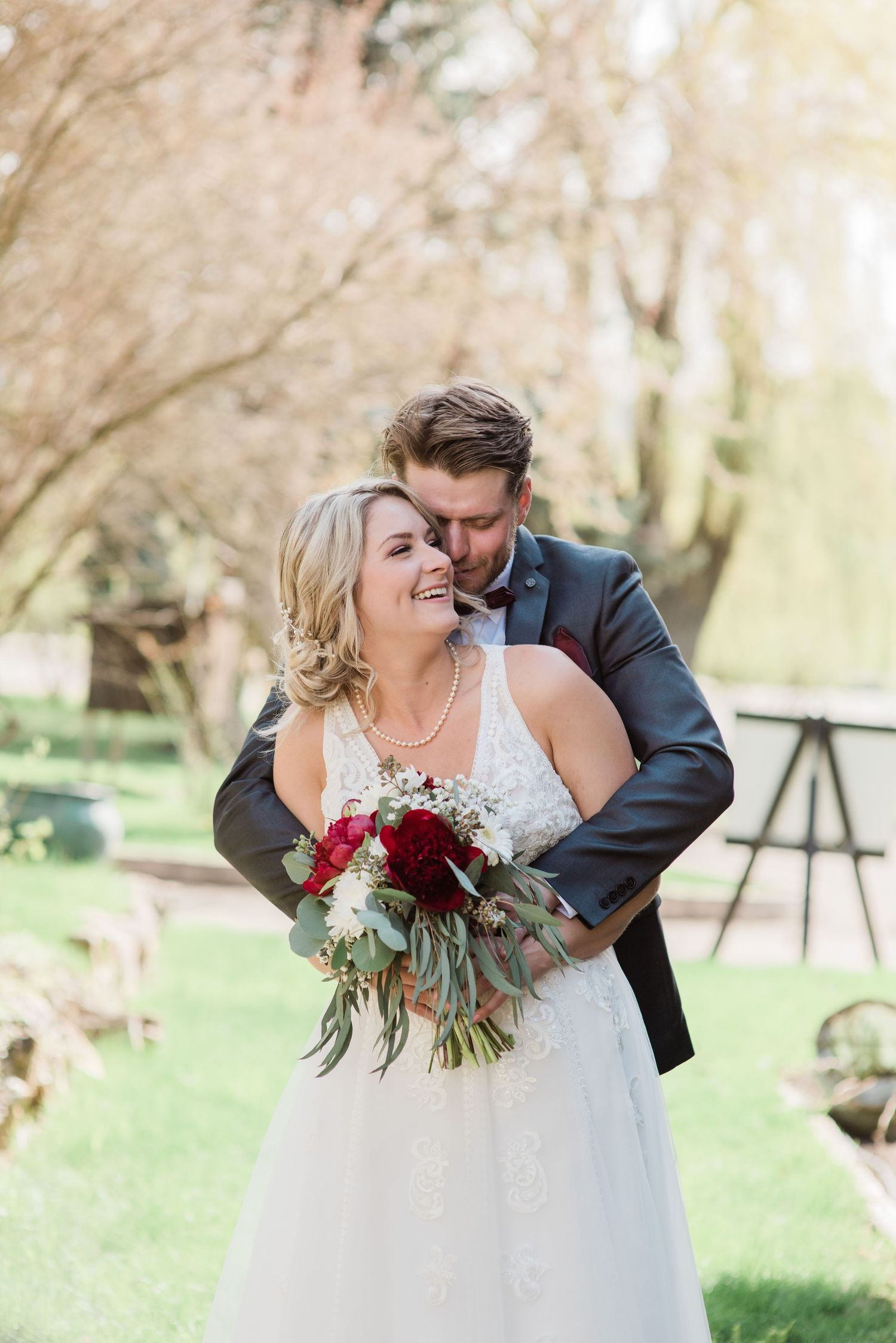 bride-and-groom-smiling-huggin-small-covid-wedding