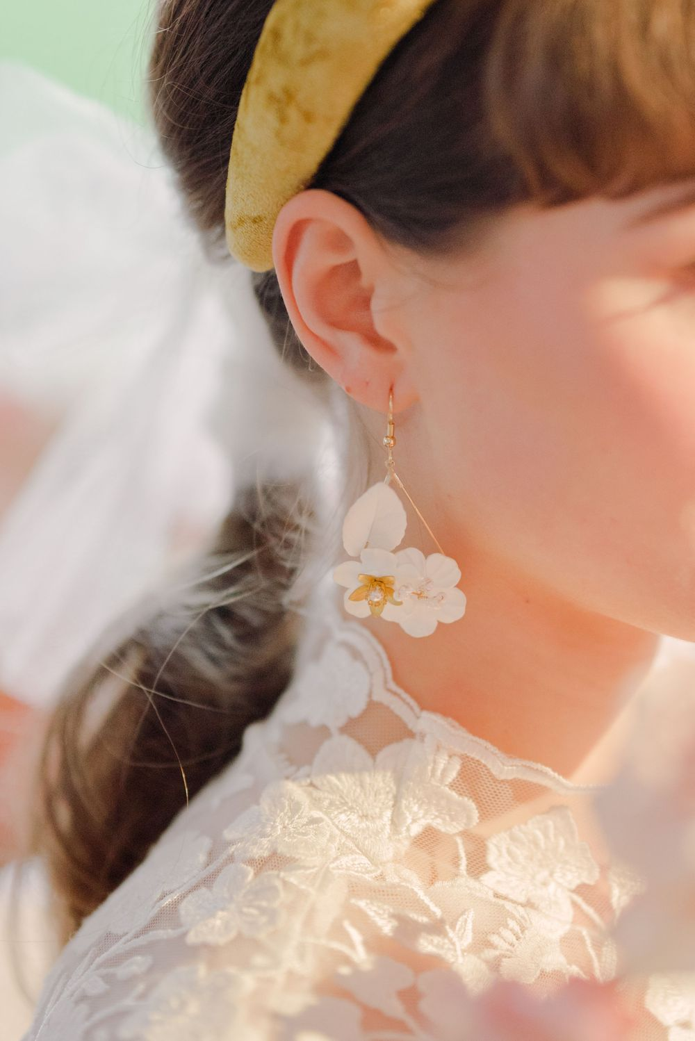 white and gold statement floral chandelier earrings by alabaster dream