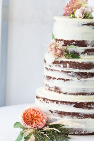 Naked cake with peach flowers in Maine