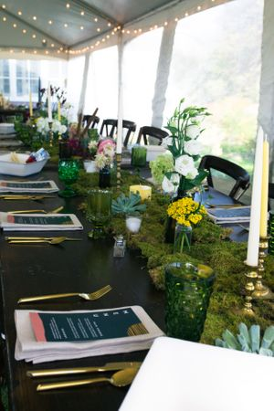 Moss lined tables with wildflowers in Boothbay harbor