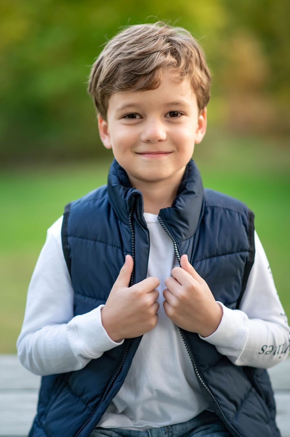Little boy gets ready for fall with his vest in butler Pennsylvania