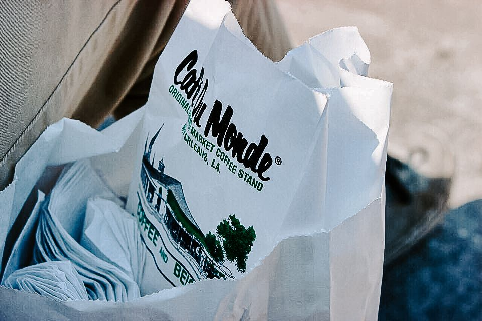 Cafe du Monde beignet bag with a lot of napkins