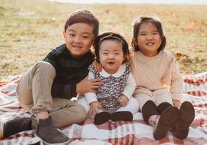 three siblings laughing by boston family photographer
