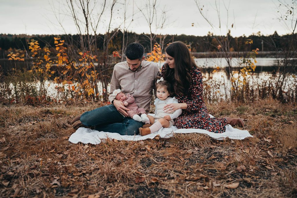 family on a blanket during a boston newborn photoshoot
