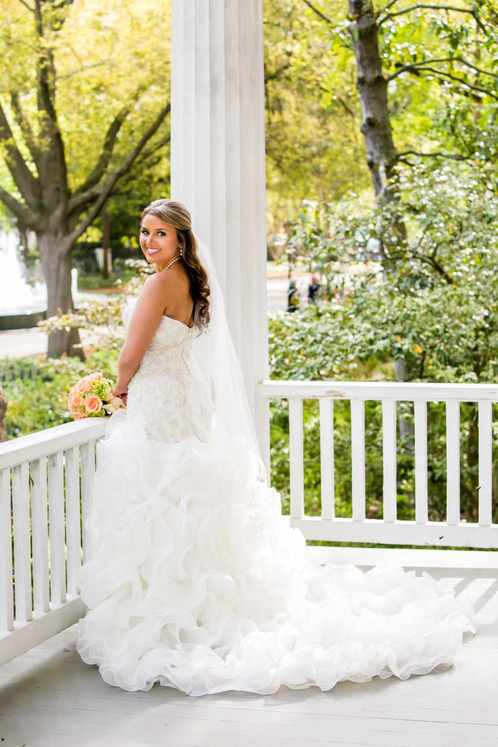 Bride Angela poses on the porch of the Caldwell-Boylston House at the SC Lace House in Columbia, SC