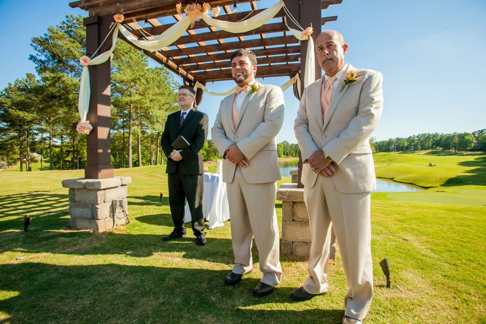 Groom Justin watches his bride walk down the aisle during a wedding ceremony at Cobblestone Golf Club in Blythewood, SC