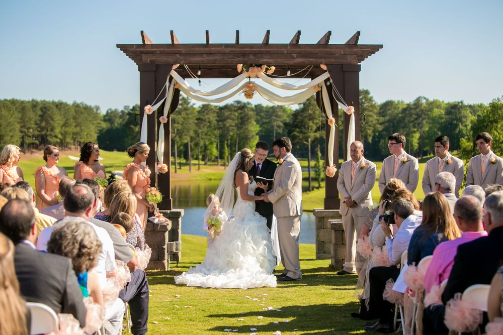 Bride Angela and groom Justin exchange vows during a wedding ceremony at Cobblestone Golf Club in Blythewood, SC