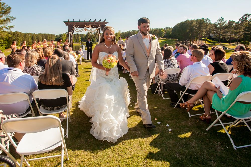 Bride Angela and groom Justin walk down the aisle following a wedding ceremony at Cobblestone Golf Club in Blythewood SC