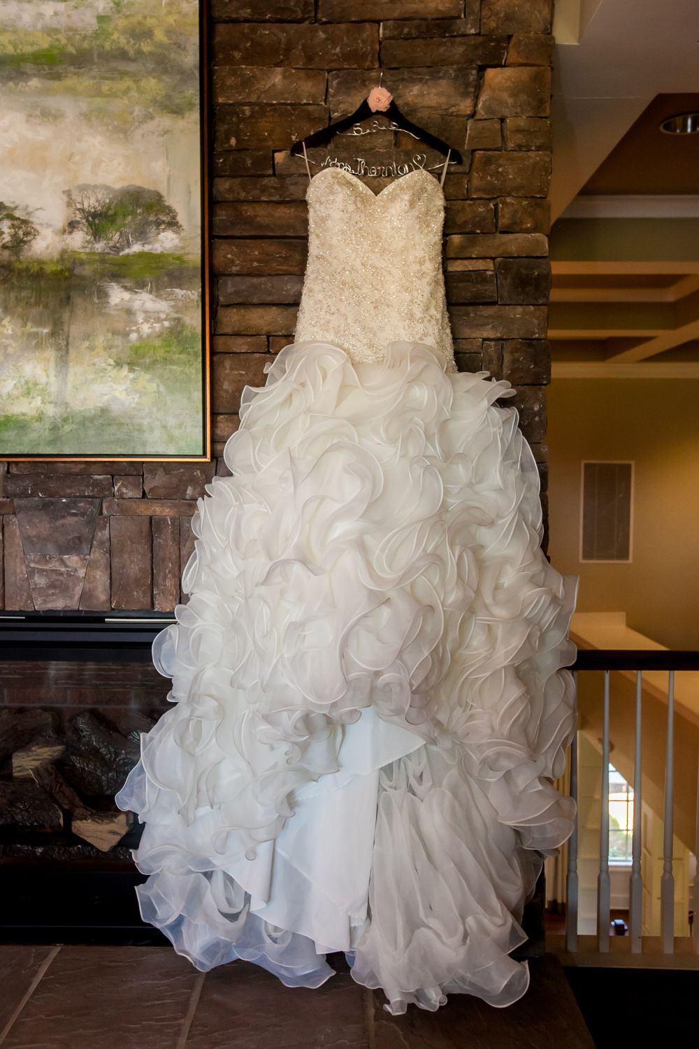 Angela's bridal gown hangs before a wedding ceremony at Cobblestone Golf Club in Blythewood, SC