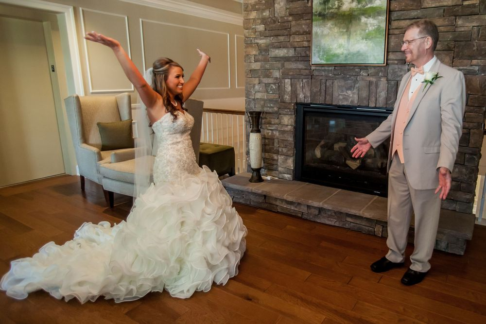 Bride Angela has a first look with her father before a wedding ceremony at Cobblestone Golf Club in Blythewood, SC