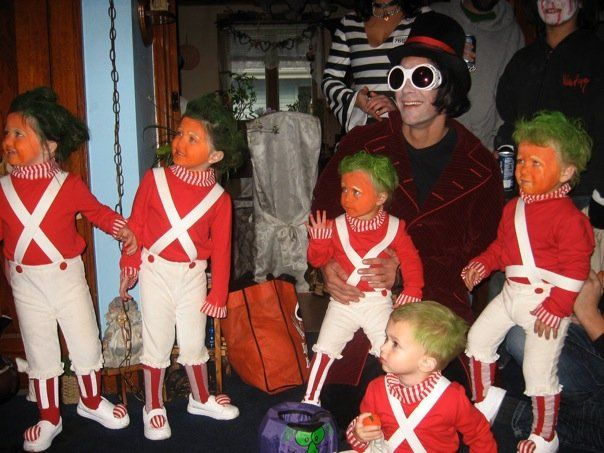 5 kids dressed as oompa loompas for halloween with willy wonka