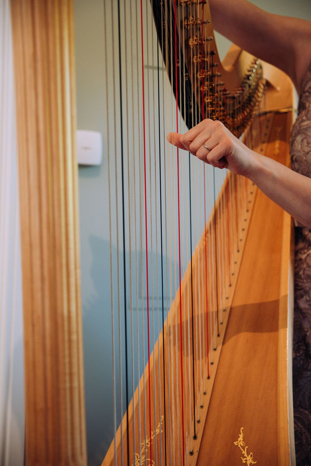 Zara Davis Wedding Photography near Stroud, Gloucestershire in the Cotswolds Ellenborough Park harpist playing