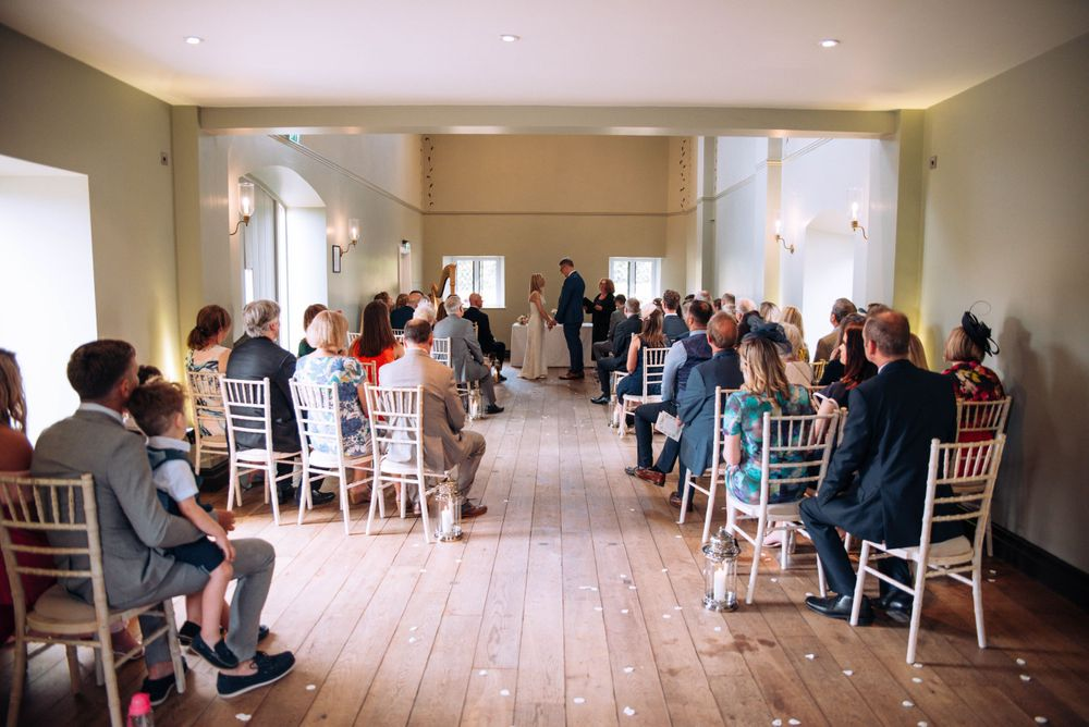 Zara Davis Wedding Photography near Stroud, Gloucestershire in the Cotswolds Ellenborough Park all the guests in chapel