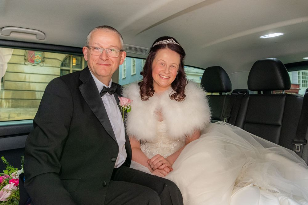 Father and bride in the car, Wedding at The University Church of St Mary the Virgin