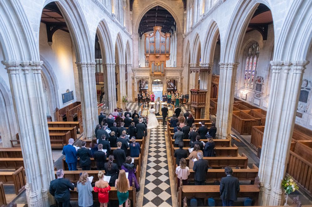 looking over the balcony at The University Church of St Mary the Virgin Wedding