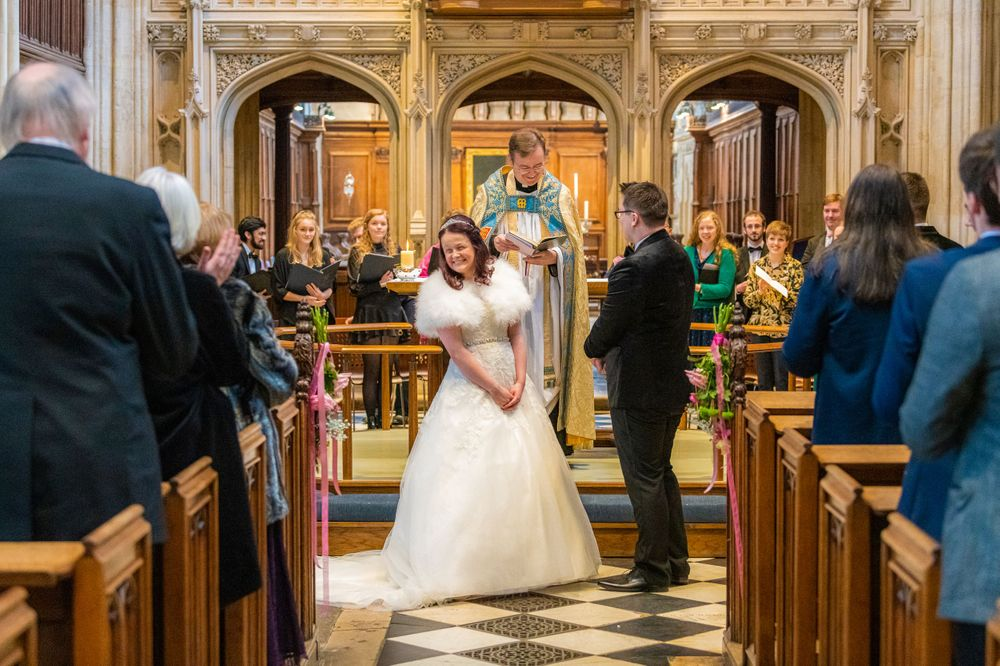 bride celebrates at The University Church of St Mary the Virgin Wedding
