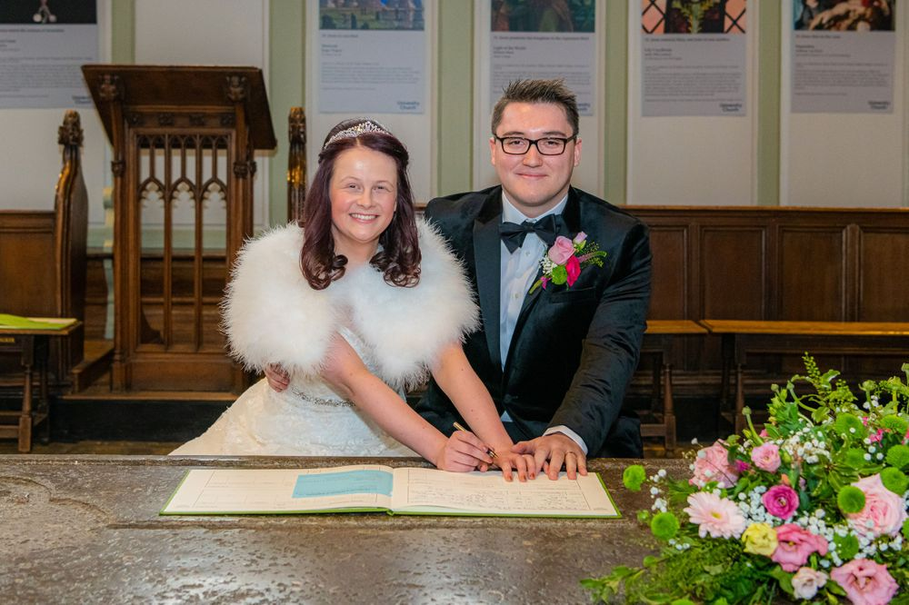 signing the register at The University Church of St Mary the Virgin Wedding