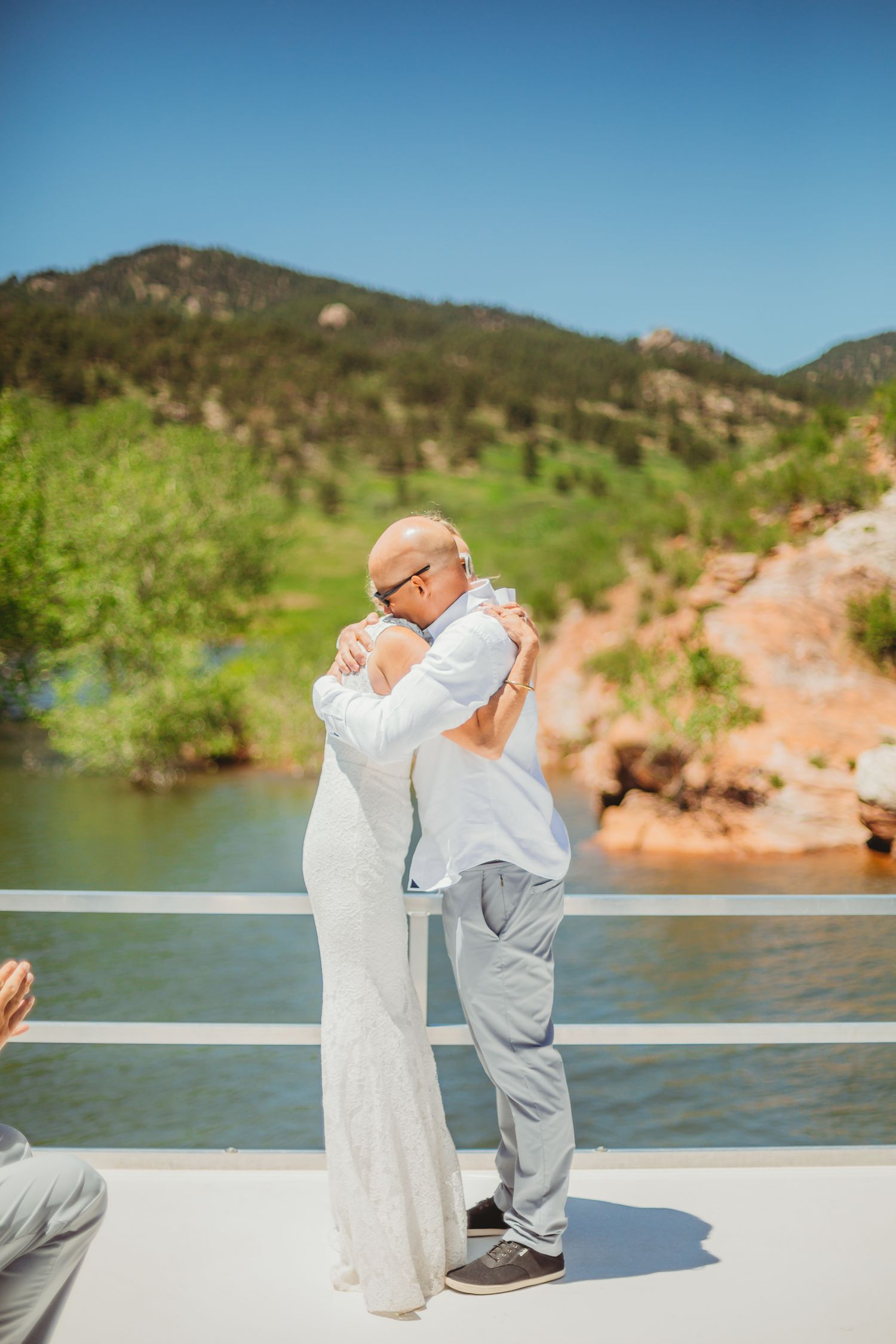 Bride and Groom hold hands during their Fort Collins.