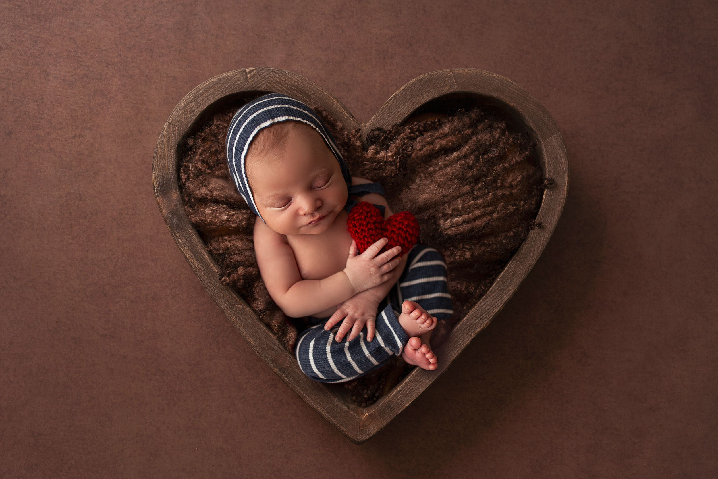 baby in heart prop newborn photographer puerto rico
