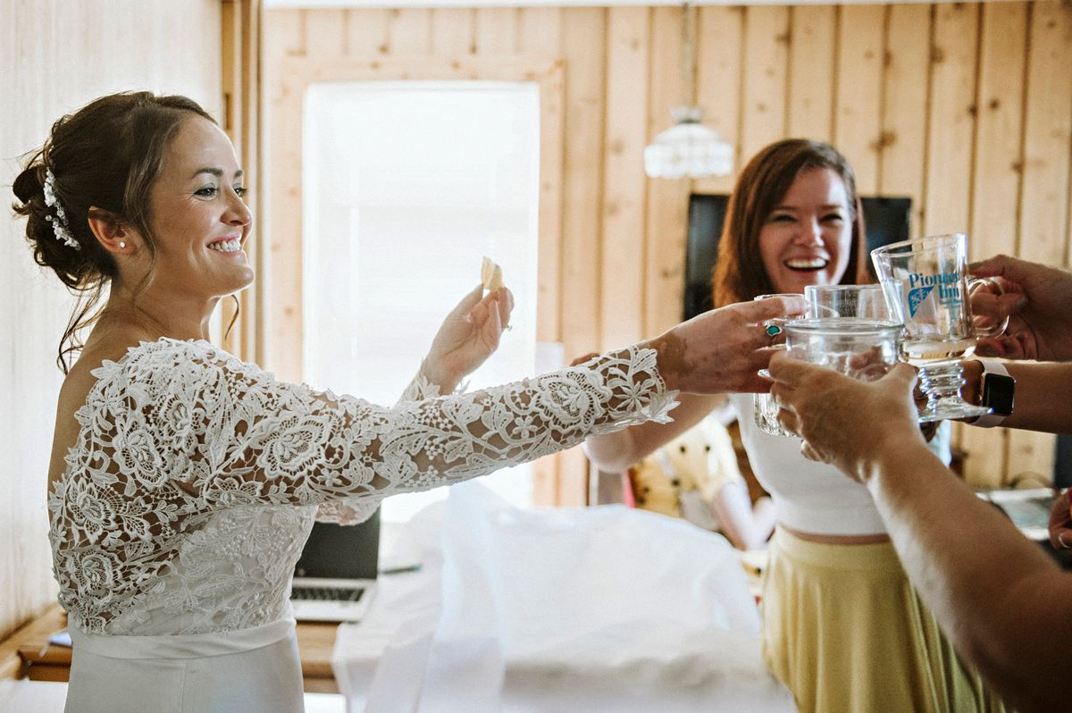 Bride toasts with bridesmaids before her wedding